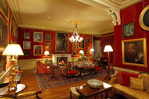 Aldourie Castle - Red Drawing Room at night. Inverness, Scotland