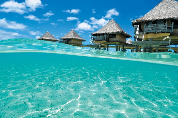 InterContinental Le Moana's unique bungalows are poised over the water and offer the ultimate island escape.
